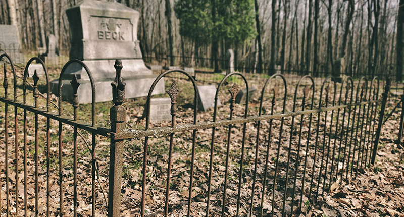 Iron fence surrounds a plot in Glenbeulah Cemetery